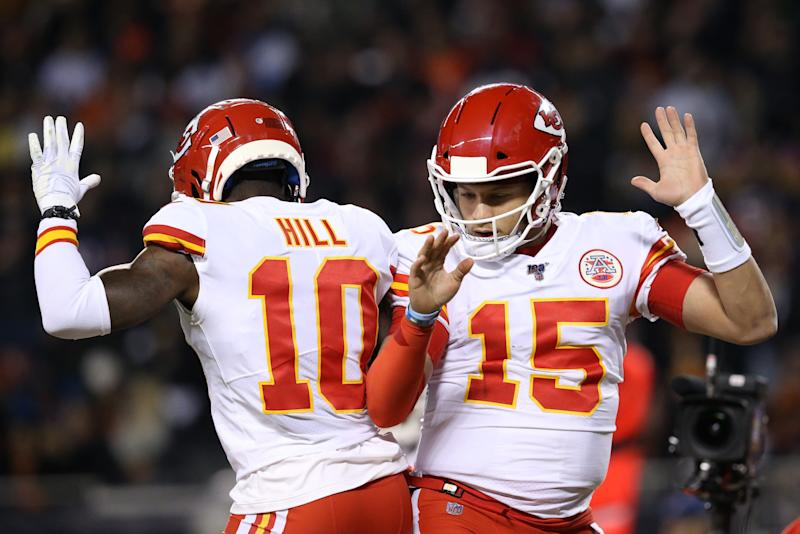 Quarterback Patrick Mahomes #15 of the Kansas City Chiefs celebrates with teammate wide receiver Tyreek Hill #10