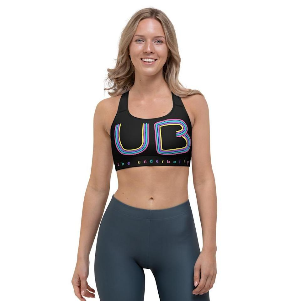 """<p><strong>The Underbelly</strong></p><p>theunderbelly.com</p><p><strong>$35.00</strong></p><p><a href=""""https://shop.theunderbelly.com/products/ub-sports-bra"""" rel=""""nofollow noopener"""" target=""""_blank"""" data-ylk=""""slk:Shop Now"""" class=""""link rapid-noclick-resp"""">Shop Now</a></p>"""