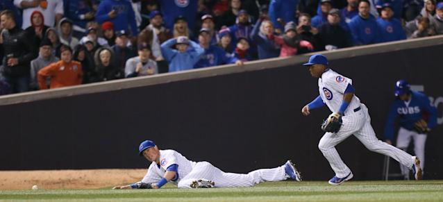 Chicago Cubs left fielder Chris Coghlan dives but is unable to reach a double off the bat of St. Louis Cardinals' Jason Heyward in third inning action during a Major League Baseball season-opening game in Chicago, Sunday, April 5, 2015. (AP Photo/St. Louis Post-Dispatch, Chris Lee)