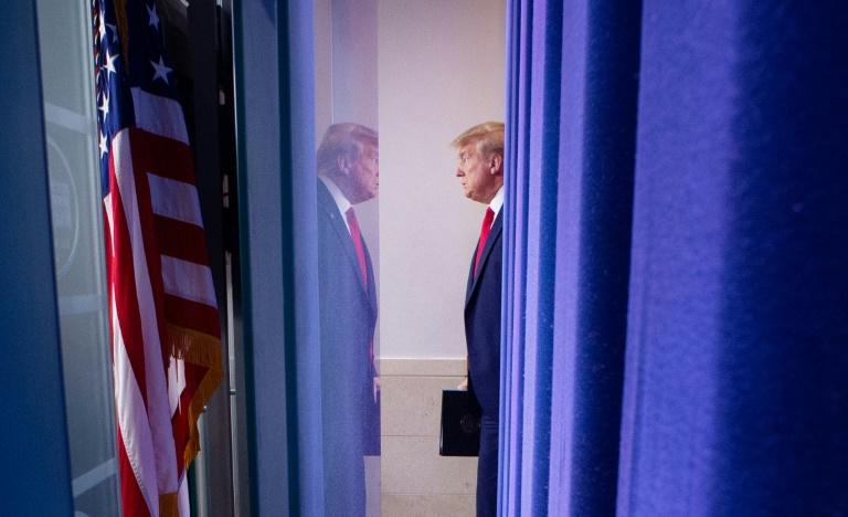 The curtain goes up on another briefing by US President Donald Trump