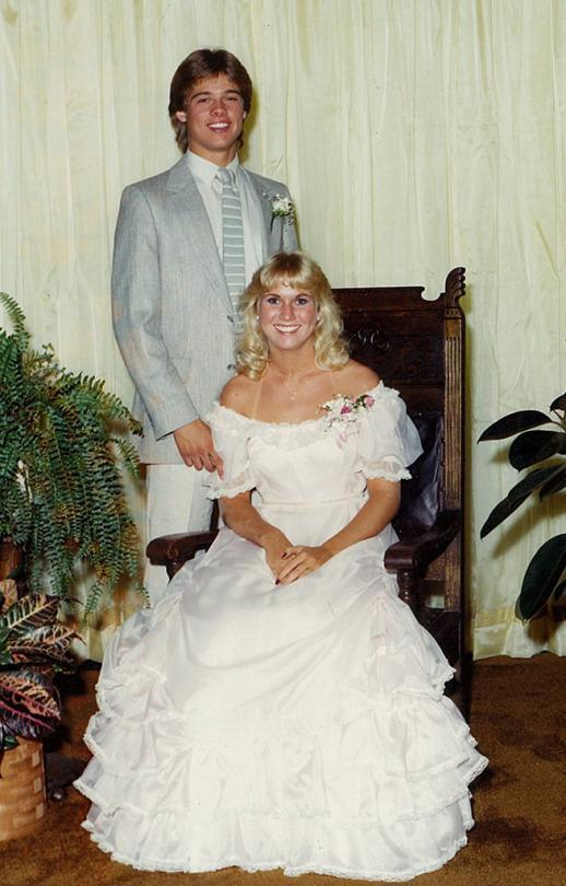 <p>Long before Jennifer Aniston and Angelina Jolie, Brad Pitt's heart belonged to Tonya Westphalen. The <em>Moneyball</em> star — who graduated from Kickapoo High School in Springfield, Mo., in 1982 — suited up to take his pretty girlfriend with some serious tan lines to prom. We can see why Pitt was voted best-dressed male in his class. (Photo: Splash News) </p>