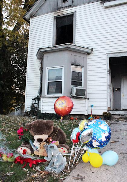 In this Nov. 3, 2013 photo provided by the Louisiana Press-Journal is a memorial in front of a home following a fire in Louisiana, Mo. The family of 3-year-old Riley Miller who was killed in the Oct. 31 fire says it is outraged after police used a stun gun on the boy's stepfather as he tried to run back in and save the child. (AP Photo/Courtesy Louisiana Press-Journal, Dave Moller) MANDATORY CREDIT