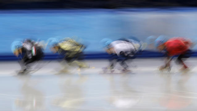 Yuri Confortola of Italy, left, leads the field in a men's 1500m short track speedskating heat at the Iceberg Skating Palace during the 2014 Winter Olympics, Monday, Feb. 10, 2014, in Sochi, Russia. (AP Photo/Vadim Ghirda)