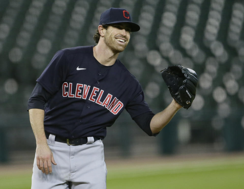 DETROIT, MI -  SEPTEMBER 17:  Starting pitcher Shane Bieber #57 of the Cleveland Indians smiles after trying to pick off Willi Castro of the Detroit Tigers at first base during the fourth inning at Comerica Park on September 17, 2020, in Detroit, Michigan. (Photo by Duane Burleson/Getty Images)