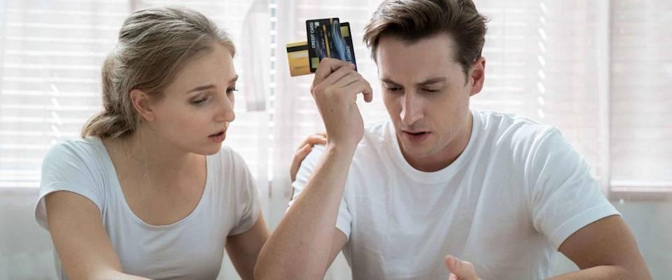 Stressed Caucasian couple, They are trying to get money to pay off their credit card debt, Financial problems from the coronavirus or covid-19 outbreak.