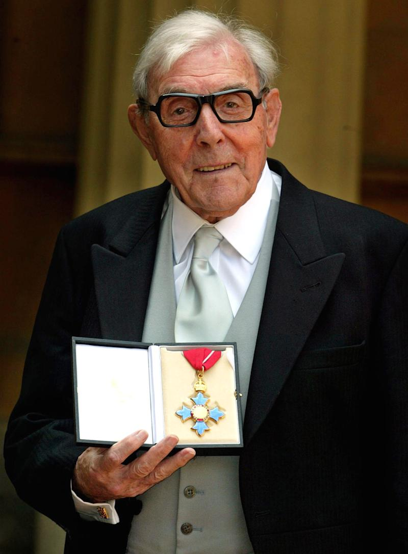 """FILE This Tuesday, June 7,  2005 file photo shows Veteran English comic actor Eric Sykes after receiving his CBE (Commander of the British Empire) award from Britain's Queen Elizabeth II at a Buckingham Palace investiture, in London. Eric Sykes, the widely-acclaimed British comedy actor and writer, died Wednesday July 4, 2012 morning after a short illness. He was 89. Sykes was one of the most popular comic actors of his generation, appearing in shows in London's West End into his 80s. He began his career writing scripts for BBC shows, co-writing 24 episodes of the classic radio comedy """"The Goon Show"""" with the late Spike Milligan.  (AP Photo / Andrew Parsons, WPA Pool)"""