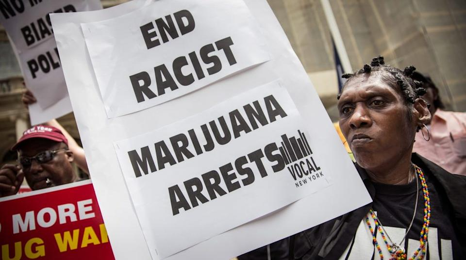 Elizabeth Owens protests on the steps of New York City Hall in support of the proposed Fairness and Equity Act, which would attempt to reform racially biased arrests in regards to marijuana possession in New York state. (Photo by Andrew Burton/Getty Images)