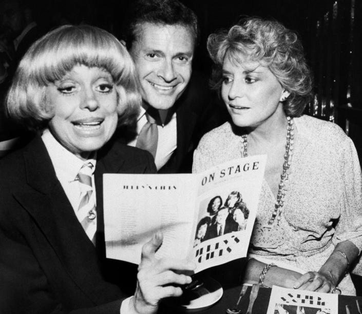 "FILE - In this Sept. 1, 1981, file photo, Carole Channing, left, and television personality Barbara Walters look over the program with composer-lyricist Jerry Herman at a Broadway Theater. Herman, the Tony Award-winning composer behind ""Hello, Dolly!"" and ""La Cage aux Folles,"" has died at age 88. (AP Photo/ David Gould)"