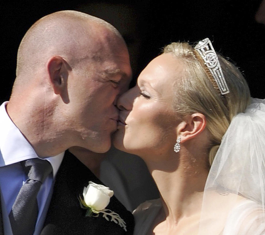 Zara Phillips and her new husband Mike Tindall outside Canongate Kirk in Edinburgh after their wedding. David McNie/Sunday Mail/PA