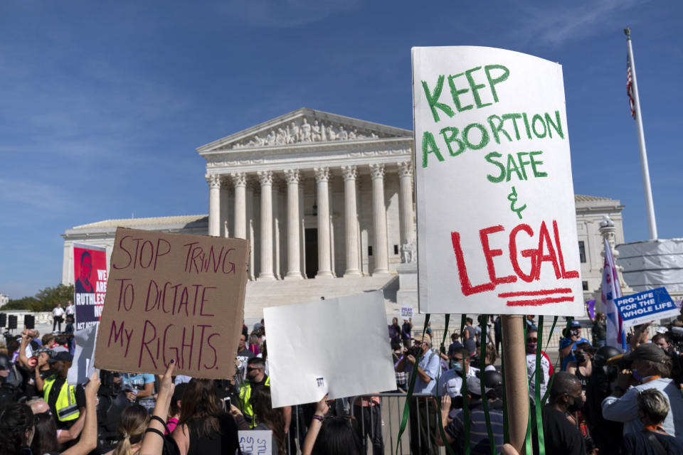 Demonstrators march outside of the the U.S. Supreme Court during the Women's March in Washington, Saturday, Oct. 2, 2021. (AP Photo/Jose Luis Magana)