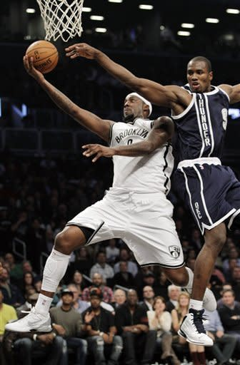 Brooklyn Nets forward Andray Blatche (0) goes up for a layup as Oklahoma City Thunder forward Serge Ibaka (9) defends in the first half of their NBA basketball game at Barclays Center, Tuesday, Dec. 4, 2012, in New York. (AP Photo/Kathy Willens)