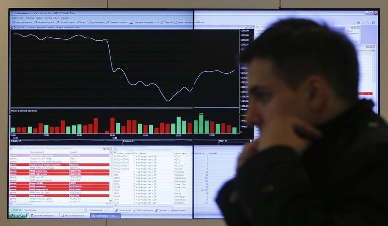 A man walks past an information screen on display inside the office of the Moscow Exchange in the capital Moscow