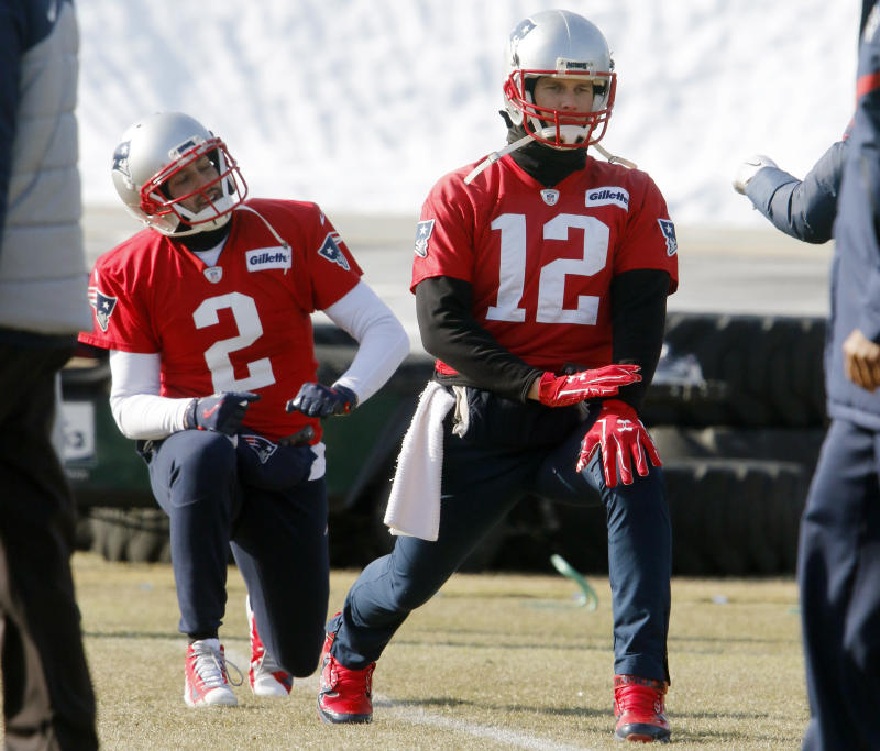 New England Patriots quarterbacks Tom Brady (12) and Brian Hoyer (2) warm up before practice Friday. (AP)