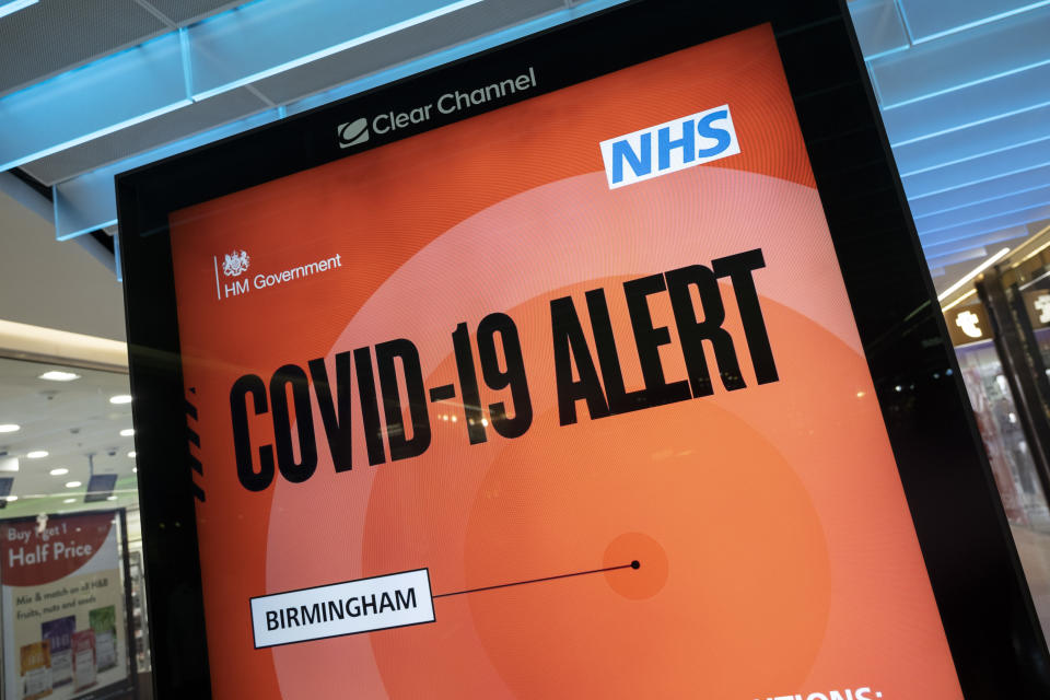 New Covid-19 Alert Public Health England, NHS information board in Grand Central shopping centre on the long awaited 'freedom day' when all remaining coronavirus restrictions are lifted in the UK on 19th July 2021 in Birmingham, United Kingdom. While many people are wearing face masks, they are no longer mandatory, while government advice suggests that it is advised to wear a face covering in busy public places inside and on transport. (photo by Mike Kemp/In Pictures via Getty Images)