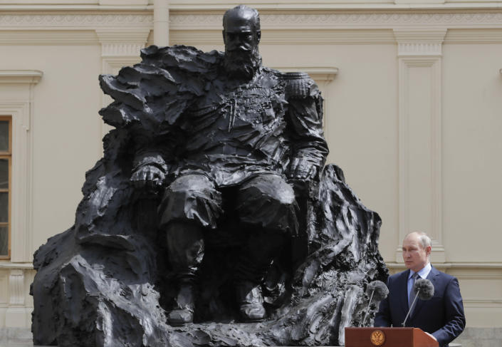 Russian President Vladimir Putin takes part in a ceremony to unveil a monument to Russian Emperor Alexander III of Russia, in Gatchina, about 45 kilometers south of St. Petersburg, Russia, Saturday, June 5, 2021. (Mikhail Metzel, TASS/Sputnik, Kremlin Pool Photo via AP)