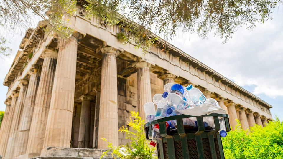Athens , Greece - July 20, 2018: Garbage bin full of plastic bottles at the Temple of Hephaestus, Greece, Athens.