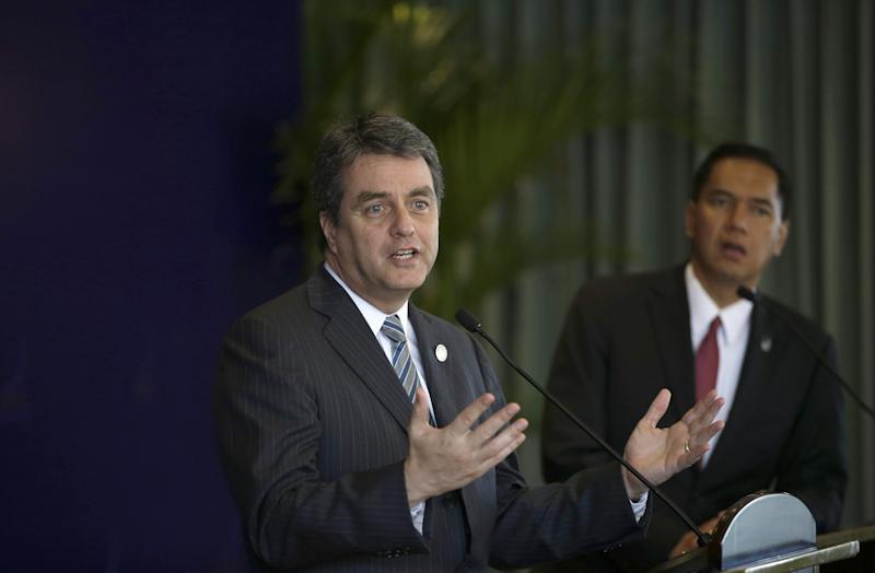 WTO Director-General Roberto Azevedo, left, speaks to the media as Indonesian Trade Minister Gita Wirjawan listens during a press conference on the sidelines of the Asia-Pacific Economic Cooperation (APEC) Ministerial Meeting in Bali, Indonesia, Saturday, Oct. 5, 2013. (AP Photo/Dita Alangkara)