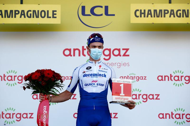 CHAMPAGNOLE FRANCE SEPTEMBER 18 Podium Remi Cavagna of France and Team Deceuninck QuickStep Celebration Trophy Flowers Mask Covid safety measures during 107th Tour de France 2020 Stage 19 a 1665km stage from Bourg en Bresse to Champagnole 547m TDF2020 LeTour on September 18 2020 in Champagnole France Photo by Benoit Tessier PoolGetty Images