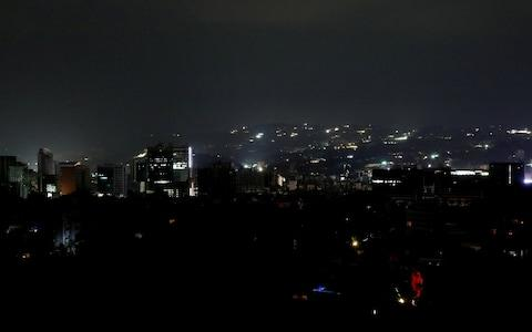 A view of Caracas during the blackout - Credit: Reuters
