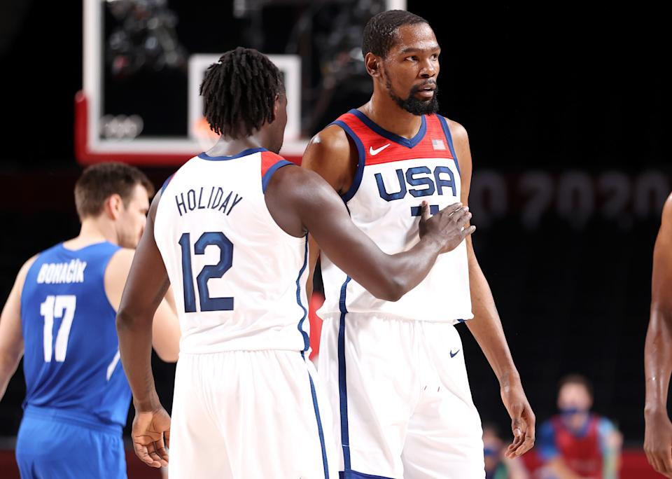 Jrue Holiday (left) pats teammate Kevin Durant on the chest during the first half of their game against Czech Republic at the Tokyo 2020 Olympic Games on July 31. (Gregory Shamus/Getty Images)