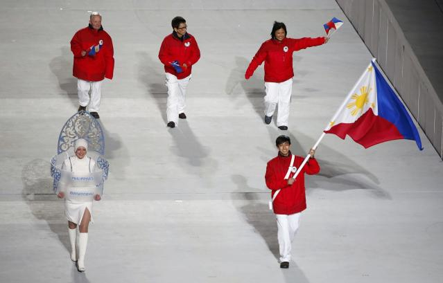 Flag-bearer Michael Christian Martinez of the Philippines leads his country's contingent during the athletes' parade at the opening ceremony of the 2014 Sochi Winter Olympics, February 7, 2014. REUTERS/Lucy Nicholson (RUSSIA - Tags: OLYMPICS SPORT)