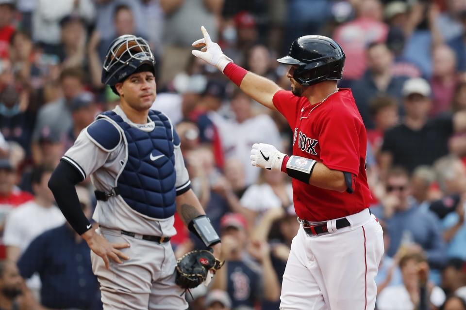 Boston Red Sox's Kevin Plawecki, right, celebrates his solo home run in front of New York Yankees' Gary Sanchez during the third inning of a baseball game, Saturday, Sept. 25, 2021, in Boston. (AP Photo/Michael Dwyer)