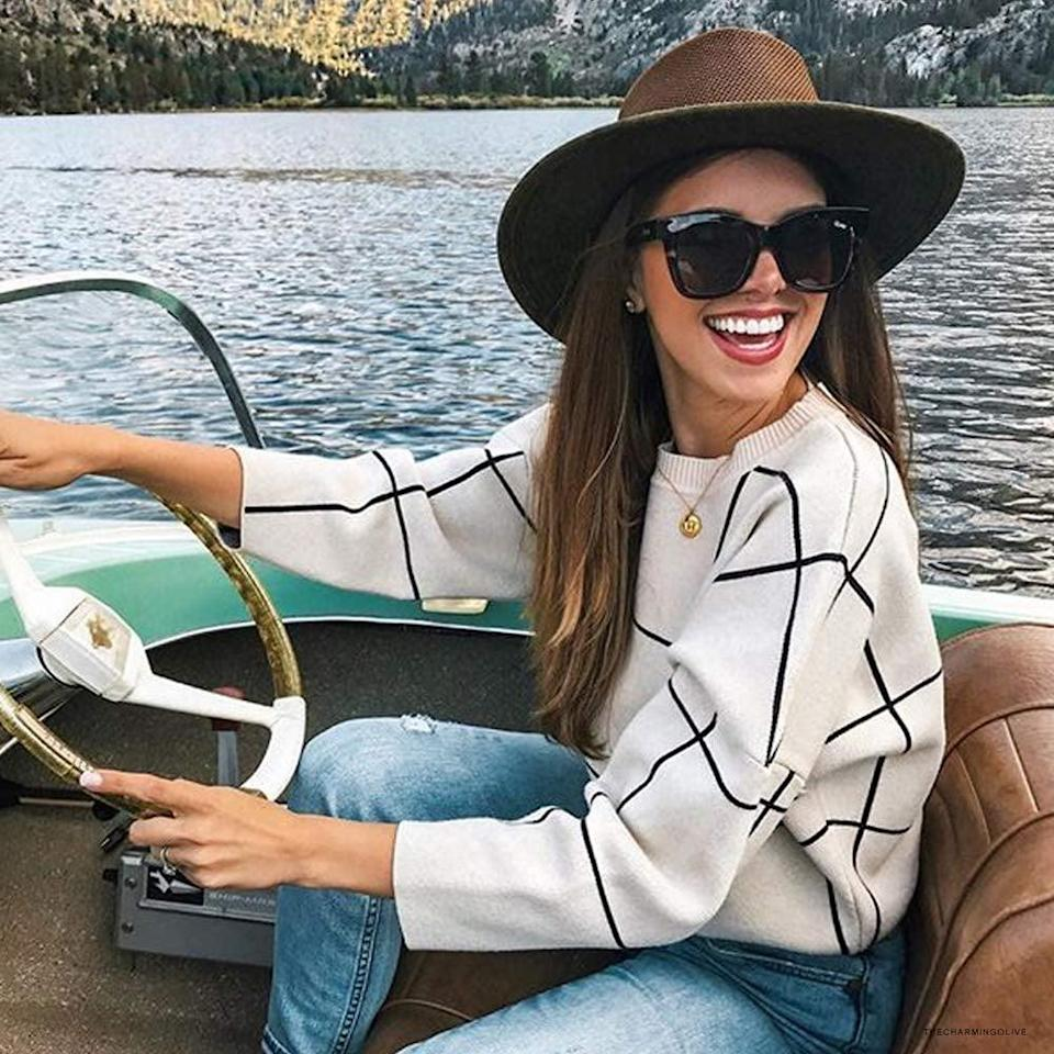 <p>The print of this <span>Chicwish Cream Grid Sweater</span> ($46) is cool and timeless, so you'll turn to it year after year. The color mix makes it easy to style.</p>