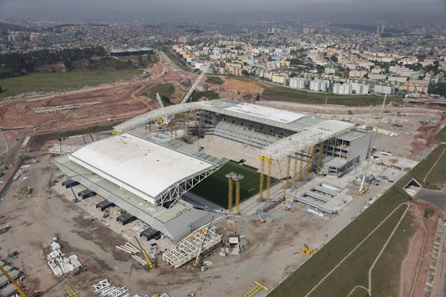 This Oct. 22, 2013 photo released by Portal da Copa 2014, shows an aerial view of the Itaquerao stadium, in Sao Paulo, Brazil. Part of the stadium that will host the World Cup opener in Brazil next year, collapsed Wednesday, Nov. 27, 2013, causing significant damage and killing three people, authorities said. (AP Photo/Delfim Martins-Portal da Copa 2014)