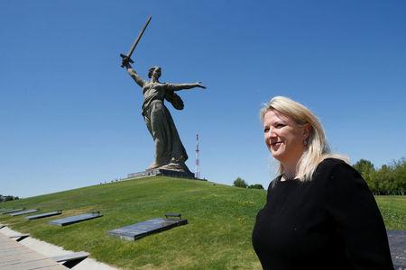 "Deputy British Ambassador to Russia Lindsay Skoll stands in front of ""The Motherland Calls"" monument at the Mamayev Kurgan World War Two memorial complex in Volgograd, Russia June 18, 2018. REUTERS/Gleb Garanich"