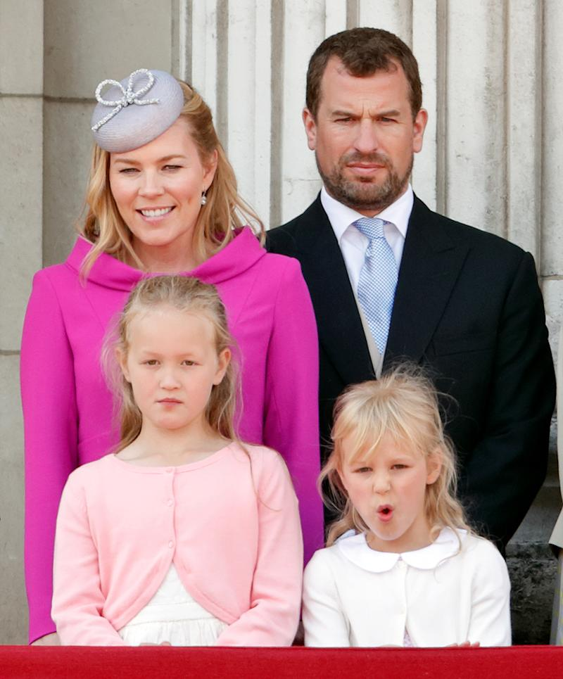 LONDON, UNITED KINGDOM - JUNE 08: (EMBARGOED FOR PUBLICATION IN UK NEWSPAPERS UNTIL 24 HOURS AFTER CREATE DATE AND TIME) Autumn Phillips, Peter Phillips, Savannah Phillips and Isla Phillips watch a flypast from the balcony of Buckingham Palace during Trooping The Colour, the Queen's annual birthday parade, on June 8, 2019 in London, England. The annual ceremony involving over 1400 guardsmen and cavalry, is believed to have first been performed during the reign of King Charles II. The parade marks the official birthday of the Sovereign, although the Queen's actual birthday is on April 21st. (Photo by Max Mumby/Indigo/Getty Images)