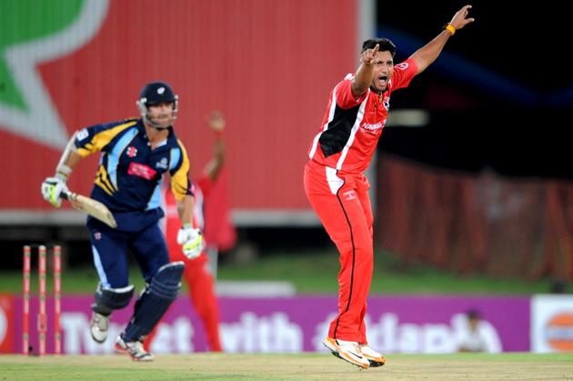 PRETORIA, SOUTH AFRICA - OCTOBER 10: Ravi Rampaul of Trinidad & Tobago celebrates the wickets of Phil Jaques of Yorkshire during the Karbonn Smart CLT20 pre-tournament Qualifying Stage match between Yorkshire (England) and Trinidad and Tobago (West Indies) at SuperSport Park on October 10, 2012 in Pretoria, South Africa.  (Photo by Lee Warren / Gallo Images / Getty Images)
