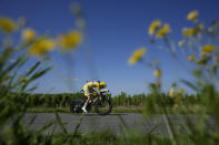 Slovenia's Tadej Pogacar, wearing the overall leader's yellow jersey, competes during the twentieth stage of the Tour de France cycling race, an individual time-trial over 30.8 kilometers (19.1 miles) with start in Libourne and finish in Saint-Emilion, France, Saturday, July 17, 2021. (AP Photo/Christophe Ena)