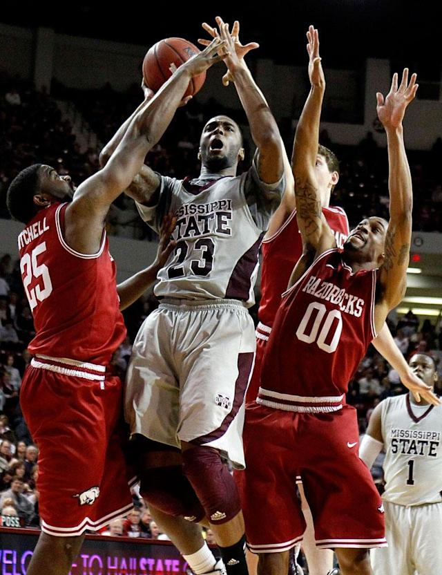 Mississippi State forward Arnett Moultrie (23) drives between Arkansas guards Brandon Mitchell (25) and Rashad Madden (00) during the second half of their NCAA college basketball game, Saturday, March 3, 2012, in Starkville, Miss. Mississippi State won 79-59.