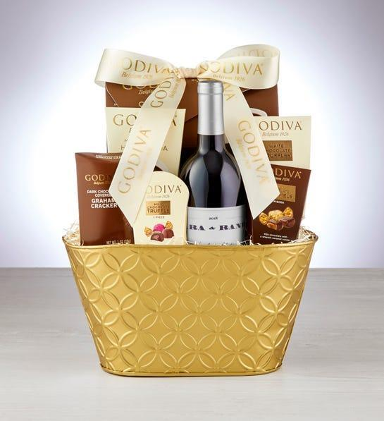 """<h2>Decadence Gift Basket with Wine</h2><br>A box of wine? Paired with creamy, decadent chocolate treats? Say no more. <br><br><strong><em><a href=""""https://fave.co/36DPAyx"""" rel=""""nofollow noopener"""" target=""""_blank"""" data-ylk=""""slk:Shop 1-800 Baskets"""" class=""""link rapid-noclick-resp"""">Shop 1-800 Baskets</a></em></strong> <br><br><strong>Godiva</strong> Decadence Gift Basket with Wine, $, available at <a href=""""https://go.skimresources.com/?id=30283X879131&url=https%3A%2F%2Fwww.1800baskets.com%2Fgodiva-decadence-gift-basket-with-wine-171640"""" rel=""""nofollow noopener"""" target=""""_blank"""" data-ylk=""""slk:1800baskets"""" class=""""link rapid-noclick-resp"""">1800baskets</a>"""