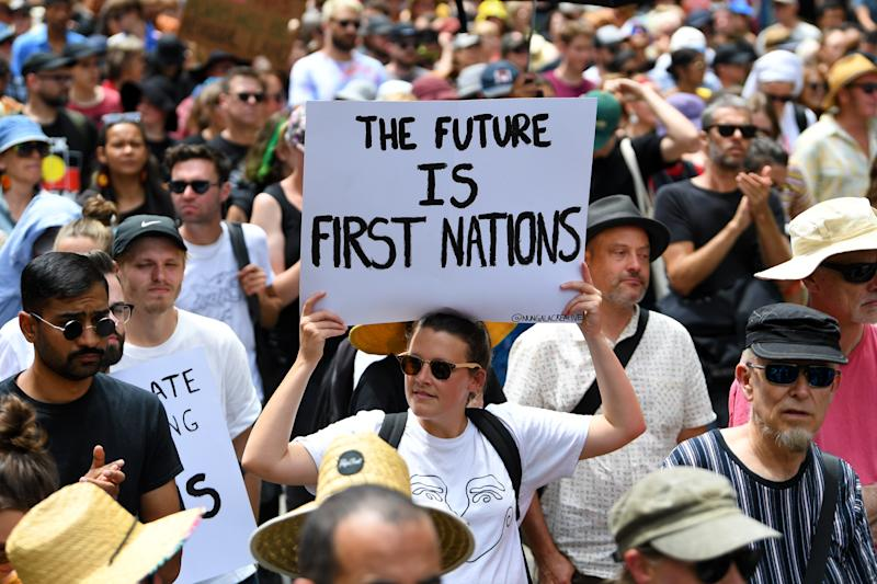 Protesters are seen during the Invasion Day rally in Melbourne.