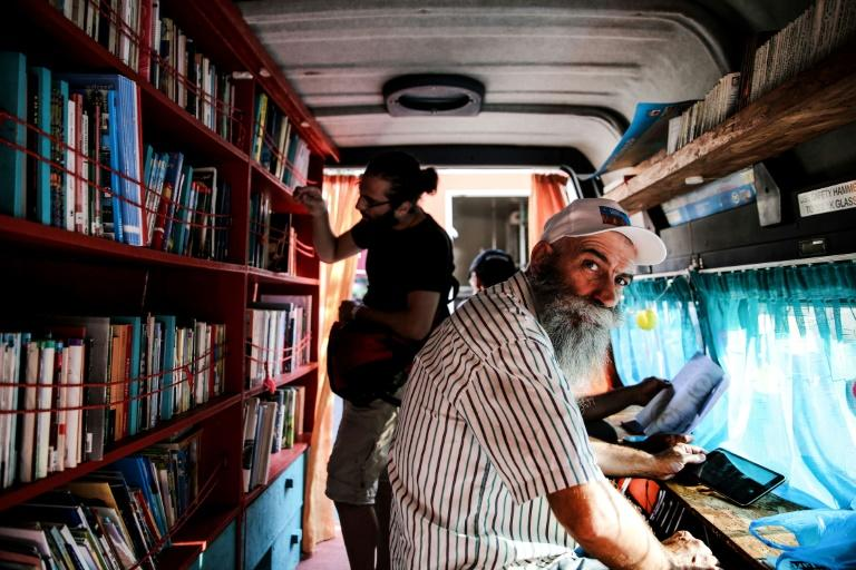 Inside the library van in Athens are books in English, Greek, Arabic, French, Kurdish and Farsi -- Agatha Christie is a favourite