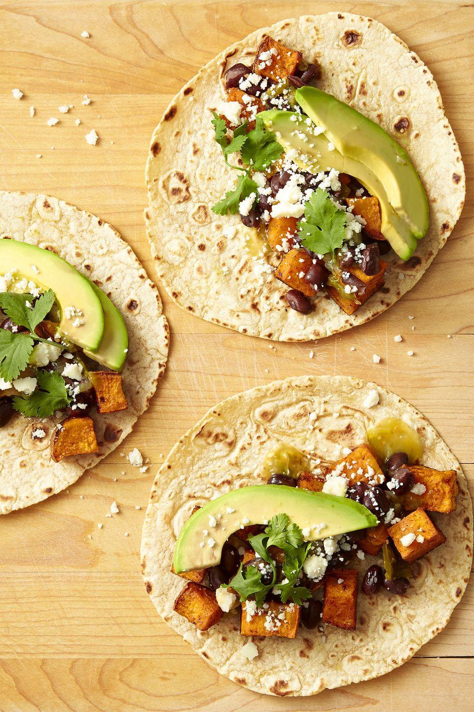 """<p>Go meat-free with these loaded tacos, complete with crumbled cotija. </p><p><em><a href=""""https://www.goodhousekeeping.com/food-recipes/easy/a44227/sweet-potato-avocado-black-bean-tacos-recipe/"""" rel=""""nofollow noopener"""" target=""""_blank"""" data-ylk=""""slk:Get the recipe for Sweet Potato, Avocado, and Black Bean Tacos »"""" class=""""link rapid-noclick-resp"""">Get the recipe for Sweet Potato, Avocado, and Black Bean Tacos »</a></em></p><p><strong>RELATED:</strong> <a href=""""https://www.goodhousekeeping.com/food-recipes/healthy/g807/vegan-recipes/"""" rel=""""nofollow noopener"""" target=""""_blank"""" data-ylk=""""slk:54 Vegan Recipes That Your Whole Family Will Love"""" class=""""link rapid-noclick-resp"""">54 Vegan Recipes That Your Whole Family Will Love</a></p>"""