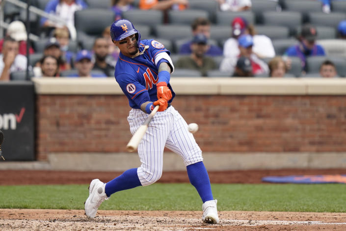 New York Mets' Javier Baez hits a two-run home run scoring Michael Conforto during the fourth inning of a baseball game against the Washington Nationals, Sunday, Aug. 29, 2021, in New York. (AP Photo/Corey Sipkin)