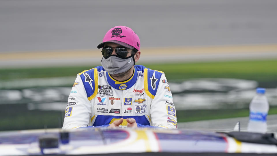 Chase Elliott leans on his car on pit road while waiting for the NASCAR Daytona 500 auto race at Daytona International Speedway, Sunday, Feb. 14, 2021, in Daytona Beach, Fla. (AP Photo/John Raoux)