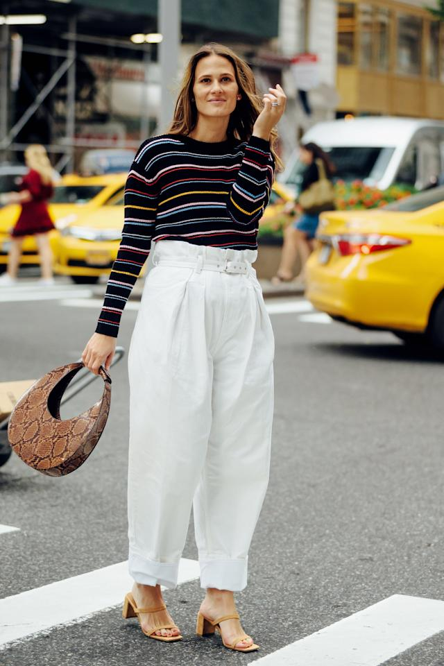 <p>The perfect early Fall outfit, play up the novelty of a striped sweater and white pants by adding in a uniquely-shaped bag in so-now snake print. Simple heels in a neutral color tie it all together while a pair of earrings will ensure a polished effect. </p>