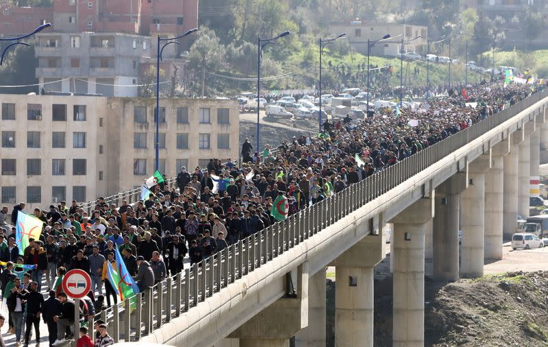 Demonstrators march during a protest in the town of Kherrata