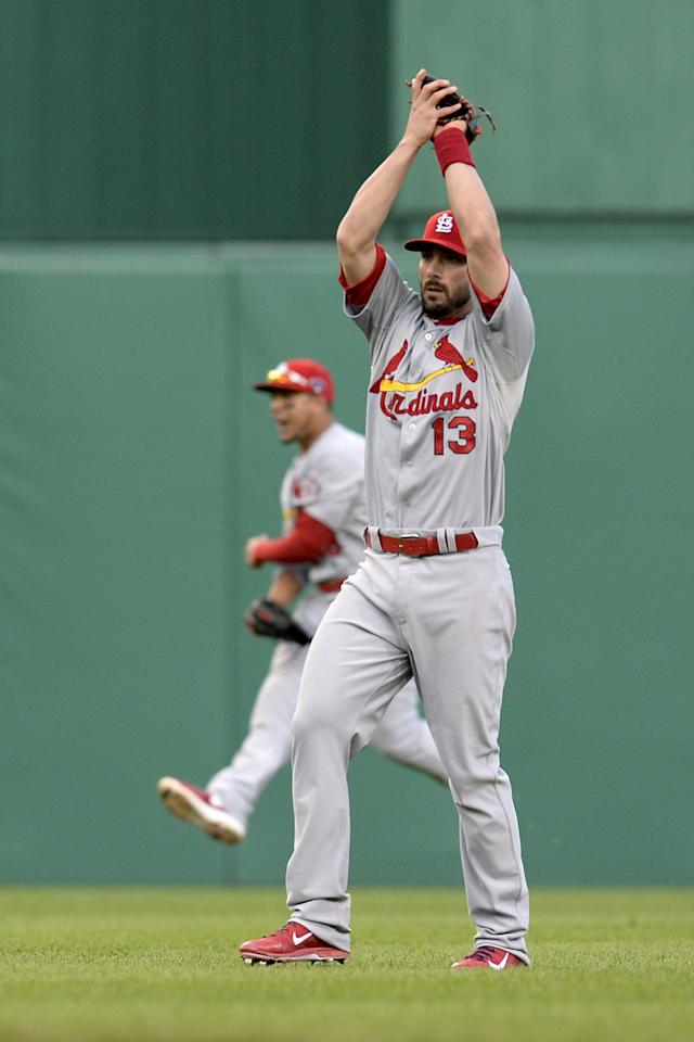 St. Louis Cardinals right fielder Carlos Beltran, rear, leaps in celebration as second baseman Matt Carpenter (13) catches a popup by Pittsburgh Pirates' Andrew McCutchen for the last out of Game 4 of a National League baseball division series Monday, Oct. 7, 2013, in Pittsburgh. The Cardinals won 2-1 to even the best-of-five series. (AP Photo/Don Wright)