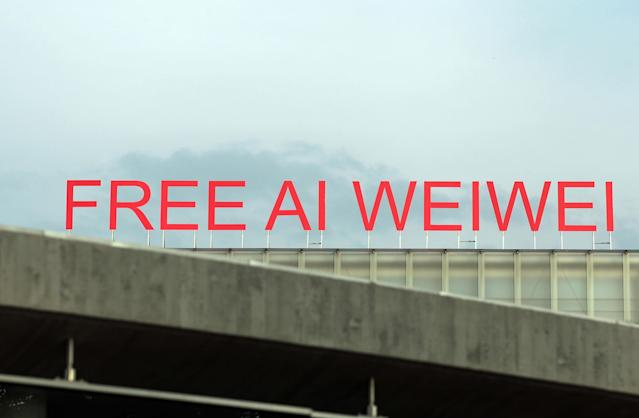 BREGENZ, AUSTRIA - JULY 15: Giant letters reading 'Free Ai Weiwei' are seen on top of the roof of Kunsthaus Bregenz on the opening night of an exhibition that focusses on the architectural work of the Chinese artist on July 15, 2011 in Bregenz, Austria. Chinese authorities have released Ai Weiwei from detention though have thus far refused to grant him permission to travel. (Photo by Johannes Simon/Getty Images)