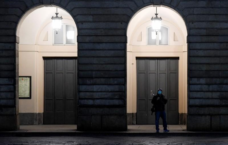 A person wearing a face mask is seen at the entrance of the Teatro alla Scala as the spread of coronavirus disease (COVID-19) continues, in Milan