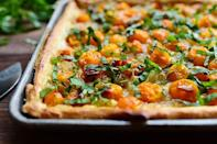 """<p>""""This was one of the most delicious things I've ever eaten,"""" Ree says of this tomato tart. """"The crust was cooked perfectly, the cheese was just the right amount, the caramelized onions sent the flavor through the roof, and the tomatoes were roasted and glorious."""" We're sold! </p><p><a href=""""https://www.thepioneerwoman.com/food-cooking/recipes/a11807/tomato-tart/"""" rel=""""nofollow noopener"""" target=""""_blank"""" data-ylk=""""slk:Get Ree's recipe."""" class=""""link rapid-noclick-resp""""><strong>Get Ree's recipe. </strong></a></p><p><a class=""""link rapid-noclick-resp"""" href=""""https://go.redirectingat.com?id=74968X1596630&url=https%3A%2F%2Fwww.walmart.com%2Fsearch%2F%3Fquery%3Dsheet%2Bpans&sref=https%3A%2F%2Fwww.thepioneerwoman.com%2Ffood-cooking%2Fmeals-menus%2Fg36500577%2Ftomato-recipes%2F"""" rel=""""nofollow noopener"""" target=""""_blank"""" data-ylk=""""slk:SHOP SHEET PANS"""">SHOP SHEET PANS</a></p>"""