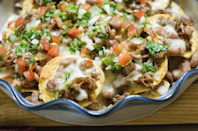 """<p>Taco-seasoned hamburger meat makes these nachos a meal in their own right.</p><p><strong><a href=""""https://thepioneerwoman.com/cooking/cowboy-nachos/"""" rel=""""nofollow noopener"""" target=""""_blank"""" data-ylk=""""slk:Get the recipe"""" class=""""link rapid-noclick-resp"""">Get the recipe</a>.</strong></p><p><strong><strong><a class=""""link rapid-noclick-resp"""" href=""""https://go.redirectingat.com?id=74968X1596630&url=https%3A%2F%2Fwww.walmart.com%2Fip%2FThe-Pioneer-Woman-Vintage-Floral-3-Piece-Serving-Bowl-Set%2F115837521&sref=https%3A%2F%2Fwww.thepioneerwoman.com%2Ffood-cooking%2Fmeals-menus%2Fg32157273%2Ffourth-of-july-appetizers%2F"""" rel=""""nofollow noopener"""" target=""""_blank"""" data-ylk=""""slk:SHOP SERVING BOWLS"""">SHOP SERVING BOWLS</a></strong><br></strong></p>"""