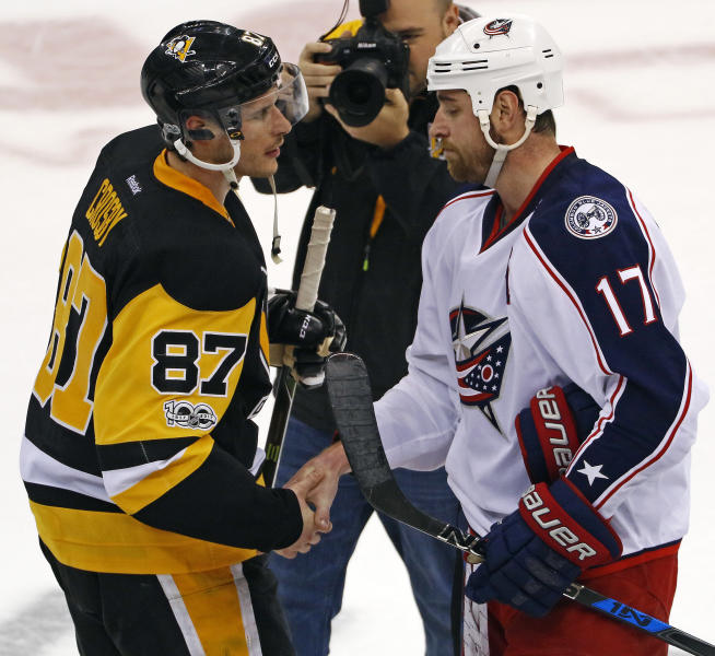 Pittsburgh Penguins' Sidney Crosby (87) shakes hands with Columbus Blue Jackets' Brandon Dubinsky (17) after a 5-2 Penguins win in Game 5 of an NHL first-round hockey playoff series in Pittsburgh, Thursday, April 20, 2017. The Penguins won the series. (AP Photo/Gene J. Puskar)