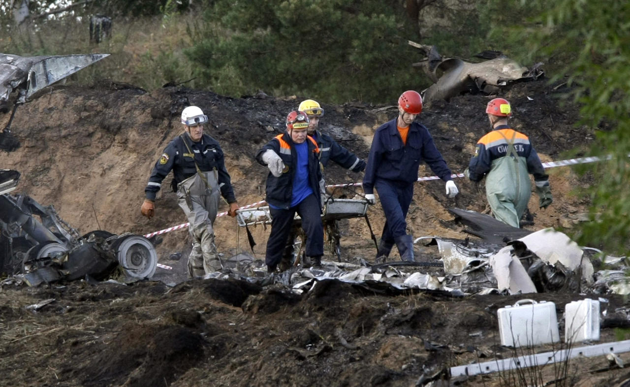 Rescuers carry a stretcher with the body of a victim at the crash site of the Russian Yak-42 jet near the city of Yaroslavl, on the Volga River about 150 miles (240 kilometers) northeast of Moscow, Russia, Wednesday, Sept. 7, 2011. The Yak-42 jet carrying a top ice hockey team crashed while taking off Wednesday in western Russia. The Russian Emergency Situations Ministry said the plane was carrying the Lokomotiv ice hockey team. (AP Photo/Misha Japaridze)