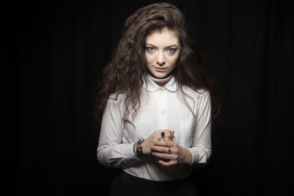 """FILE - In this Nov. 8, 2013 file photo, Australian singer Lorde poses for a portrait, in New York. Lorde's """"Royals"""" could be crowned with Grammy gold. The breakthrough singer will perform at the Grammy Awards nominations special on Friday, Dec. 6, 2013, in Los Angeles. (Photo by Victoria Will/Invision/AP, File)"""