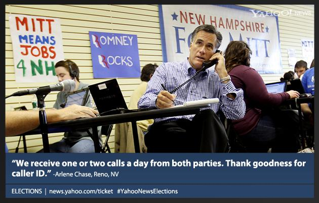 Republican 2012 presidential candidate, former Massachusetts Gov. Mitt Romney, center, works with volunteers making calls while visiting his Romney For President New Hampshire Headquarters in Manchester, N.H., Saturday, Oct. 22, 2011.